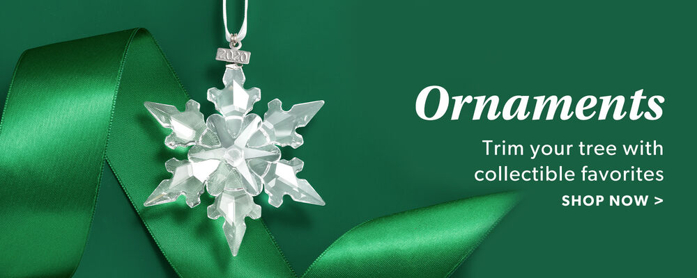 Ornaments. Trim your tree with collectible favorites. Shop Now. Image of swarovski crystal snowflake ornament.