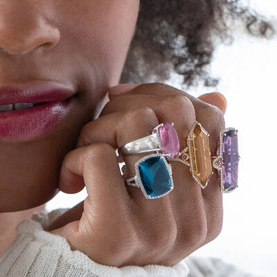 Discover colorful styles. Shop Gemstone Rings. Image Featuring Model Wearing Gemstone Rings