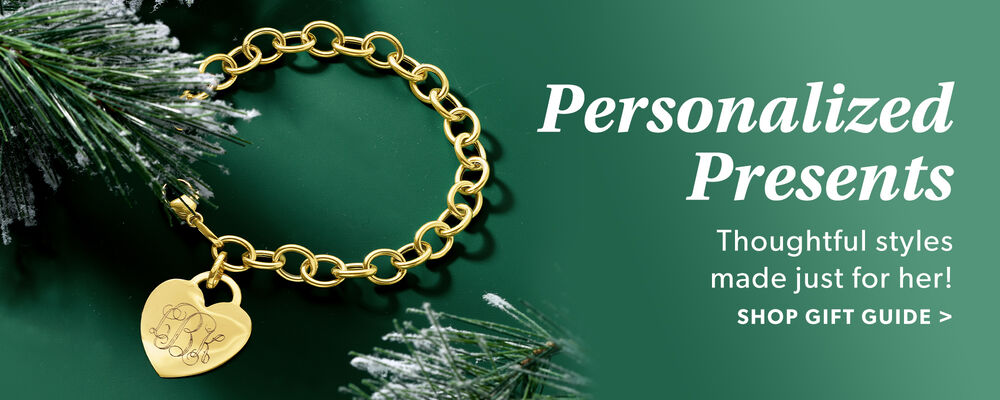 Personalized Presents. Thoughtful Styles Made Just For Her! Shop Gift Guide. Image Featuring Gold Bracelet on Green Background