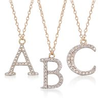 """Image of """".10 ct. t.w. Diamond Initial """"U"""" Necklace in 14kt Yellow Gold. 18"""""""""""