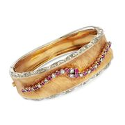 C. 1960 Vintage 1.05 ct. t.w. Ruby and .85 ct. t.w. Diamond Bangle Bracelet in 18kt Two-Tone Gold. 7""