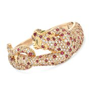 C. 1980 Vintage 16.00 ct. t.w. Diamond and 6.00 ct. t.w. Ruby Panther Bangle Bracelet in 18kt Yellow Gold. 7""
