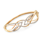 C. 1970 Vintage .85 ct. t.w. Diamond Openwork Crisscross Bangle Bracelet in 10kt Yellow Gold. 7""