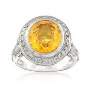 C. 1990 Vintage 5.65 Carat Oval Yellow Sapphire and .50 ct. t.w. Diamond Ring in Platinum. Size 6
