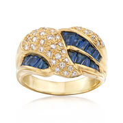 C.1990 Vintage 1.24 ct. t.w. Sapphire and .41 ct. t.w. Diamond Crossover Ring in 18kt Yellow Gold. Size 6.5