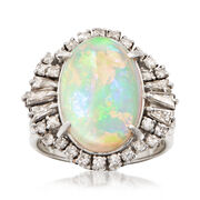 C. 1960 Vintage Opal Cabochon and .85 ct. t.w. Diamond Halo Ring in Platinum. Size 7