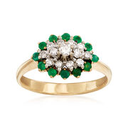 C. 1980 Vintage .32 ct. t.w. Diamond and .30 ct. t.w. Emerald Cluster Ring in 14kt Yellow Gold. Size 7
