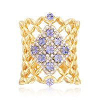 .60 ct. t.w. Tanzanite and .13 ct. t.w. Diamond Woven Band Ring in 18kt Yell..